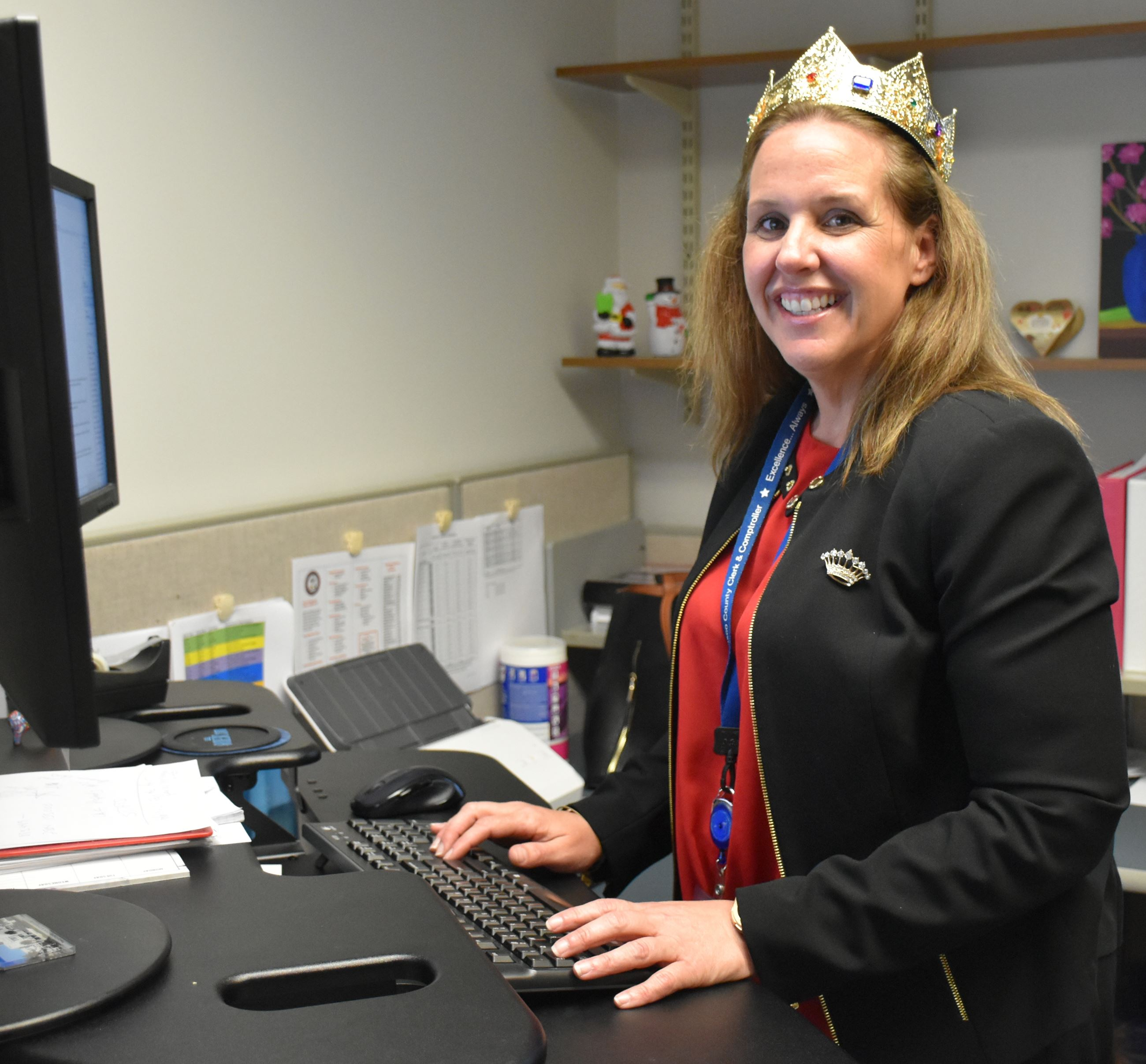 Lisa Shippy-Gonzalez, Queen Chasco 2019, at her computer in our Finance Department.